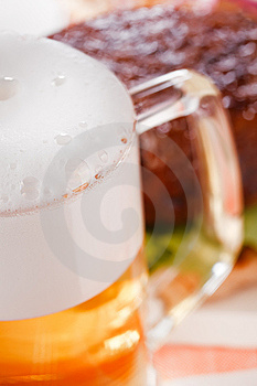 Pint Of Lager Beer With Burger On Background Royalty Free Stock Photo - Image: 7024515