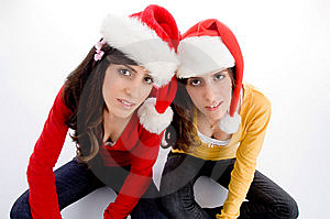 Sitting Females With Christmas Hat Stock Photography - Image: 7026102