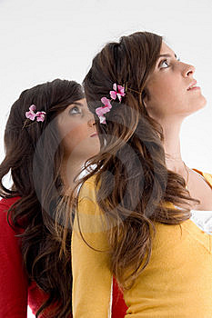 Young Friends With Flowers And Looking Upward Stock Images - Image: 7026104