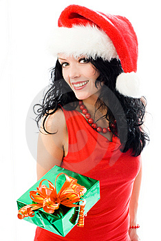 Beautiful Brunette Woman Gives A Present To Us Royalty Free Stock Image - Image: 7026776