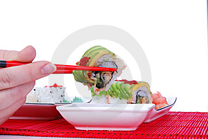 Holding One Roll With Chopsticks Royalty Free Stock Images - Image: 7039409