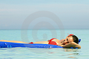 Woman Swimming On An Air Mattress Royalty Free Stock Photo - Image: 7051325