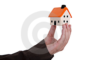 Human hand holding a house Royalty Free Stock Photos