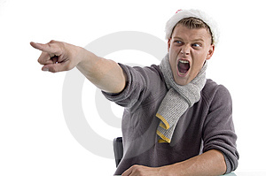 Shouting Male With Christmas Hat Pointing Aside Royalty Free Stock Photos - Image: 7058468