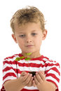 Young boy holding plant Stock Photo