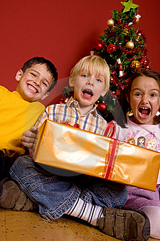 Laughing Children With Christmas Gift Stock Photography - Image: 7064992