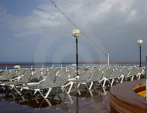 White And Blue Striped Deck Lounging Chairs Royalty Free Stock Images - Image: 720149