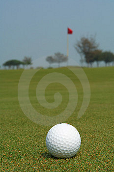 Golf ball near flag Royalty Free Stock Image
