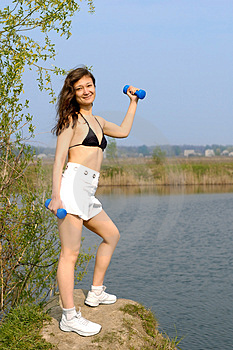 Young Woman With Weights Exercising Outdoors Stock Image - Image: 761091
