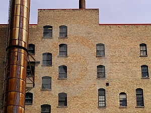 Windows And A Rusted Smokestack Royalty Free Stock Images - Image: 768619