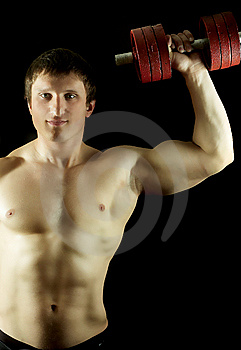 Strong Man Keeps Dumbbell Stock Photo - Image: 7702800
