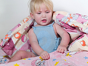 Child Pulls Blanket Stock Images - Image: 7708874