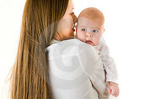 Happy Mother  Holding A Young Baby Girl Stock Image - Image: 7712831