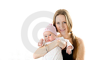 Happy Mother  Holding A Young Baby Girl Stock Photos - Image: 7712843