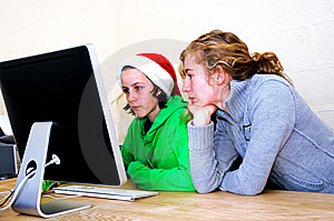 Girls Playing Games On Computer Stock Photos - Image: 7724793