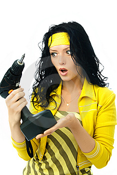 Surprised Young Woman With A Drill Stock Photography - Image: 7727962
