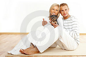 Happy couple with a puppy Stock Photo