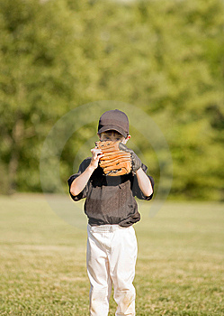 Little Boy Hiding Behind His Glove Stock Photo - Image: 7738640