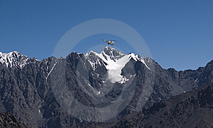 Helicopter In The Mountains Stock Photo - Image: 7751650