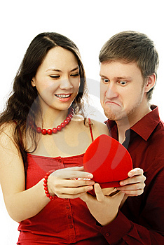 Young Couple Opening A Present Royalty Free Stock Photography - Image: 7755687