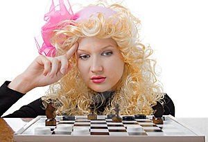 Glamor Blonde Plays A Chess Stock Images - Image: 7756314