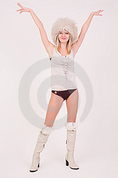 Smiling Girl In Furry Hat Rising Her Hands Up Royalty Free Stock Photo - Image: 7759765
