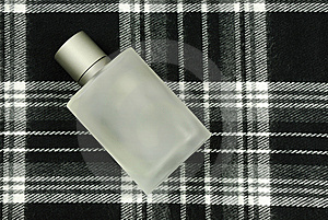 Perfume Bottle On Check Pattern Royalty Free Stock Images - Image: 7761129