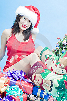 Sexy Girl With Sat On Presents Royalty Free Stock Photography - Image: 7764427