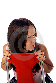 Young Woman Is Sitting On The Chair Royalty Free Stock Photos - Image: 7764818