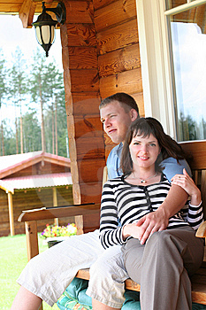 Couple Relaxing On Verandah Stock Image - Image: 7791181
