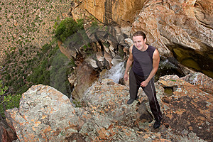 Young Hiker Stands Near Steep Waterfall Royalty Free Stock Images - Image: 7795159