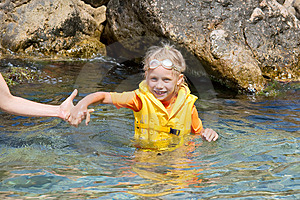 Happy Girl In Seawater Holds The Hand Stock Image - Image: 7795181