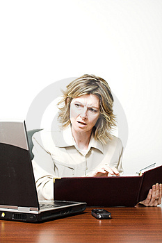 Business woman looking at laptop Stock Image