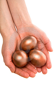 Three Gold Eggs In Palm(paths) Royalty Free Stock Photos - Image: 7804378