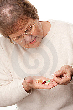 Attractive Senior Woman And Pills Stock Photos - Image: 7826483
