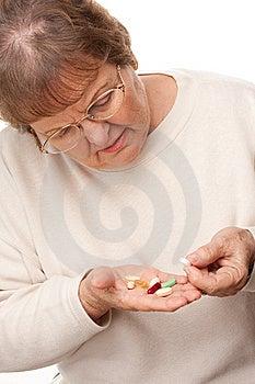 Attractive Senior Woman And Pills Stock Photos - Image: 7826483
