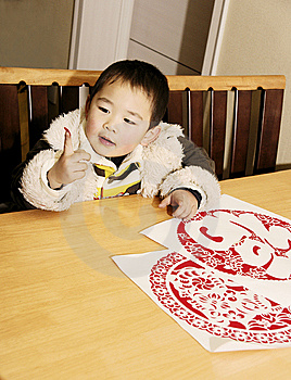 Boy And Paper-cuts Royalty Free Stock Photo - Image: 7828165