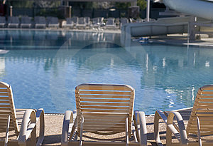 Chairs And Water Slide By Swimming Pool Stock Photography - Image: 7836772