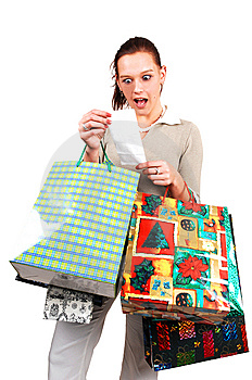 An very surprised shopping woman. Free Stock Photography