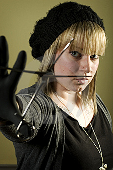 Woman Holding Forceps In Front Of Her Face Stock Photos - Image: 7852893