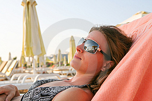Woman Sunbathing On The Beach Royalty Free Stock Photos - Image: 7855228