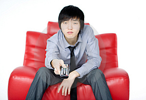 The Young Man In A Grey Shirt Watches TV Royalty Free Stock Photo - Image: 7856085