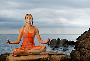 Woman doing yoga exercise Stock Photos