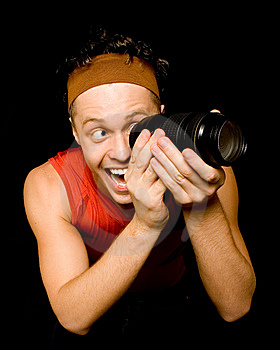Young Man Looks Through Camera Lens Stock Images - Image: 7868364