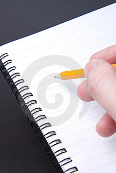 Writing in a blank spiral notebook Royalty Free Stock Images