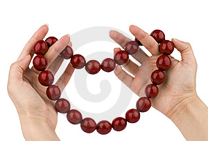 Red Beads In Hands Stock Photography - Image: 7876312