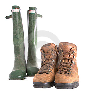 Old Walking Boots And Green Wellington Boots Royalty Free Stock Photography - Image: 7876657