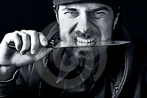 One Tough Funny Man With Knife In His Teeth Royalty Free Stock Image - Image: 7889396