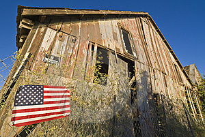 American Flag And Decrepit Building Royalty Free Stock Photos - Image: 7889568