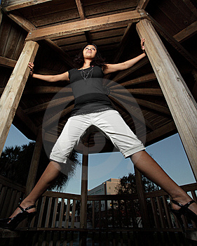 Woman Spread On A Gazebo Stock Photography - Image: 7891292